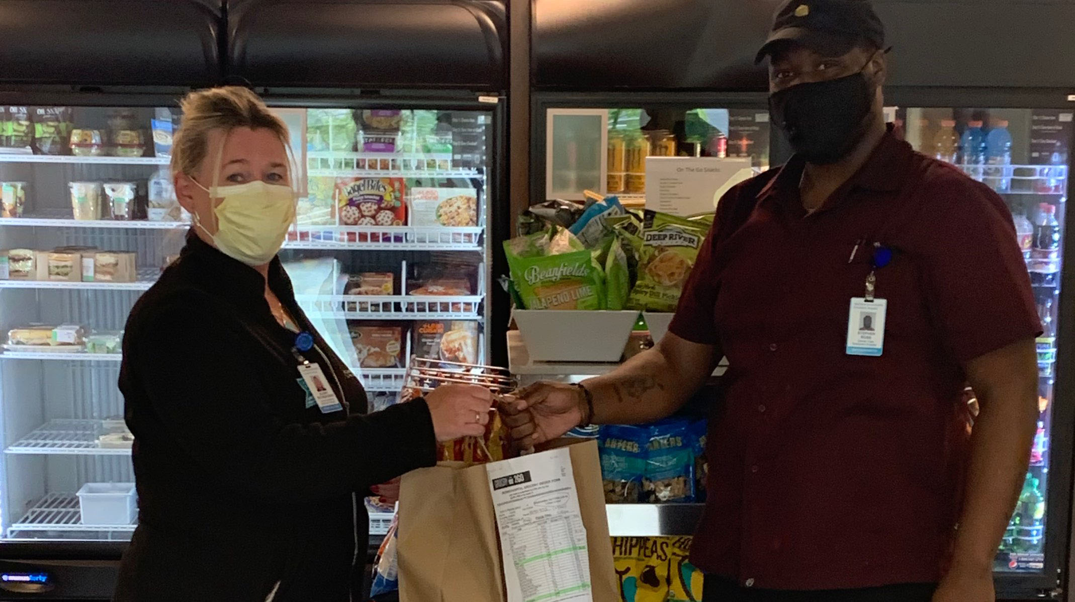 Greenwich Hospital health care worker receiving groceries