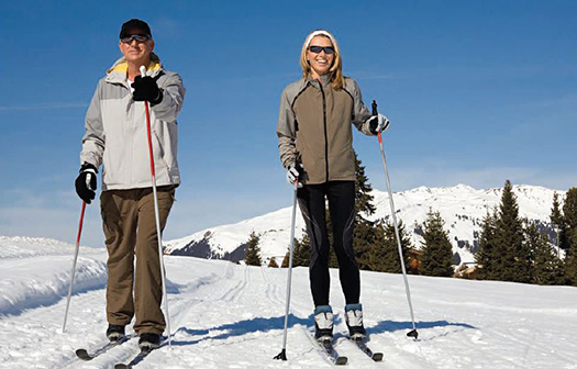 man and woman on ski slope